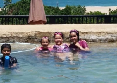 Kids in the Sugar Beach Resort pool